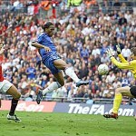Who were the first team to win the FA Cup at the New Wembley Stadium?